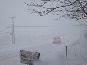 Visibility is low in today's snowstorm along the road in front of my St. Albans, Vermont home.